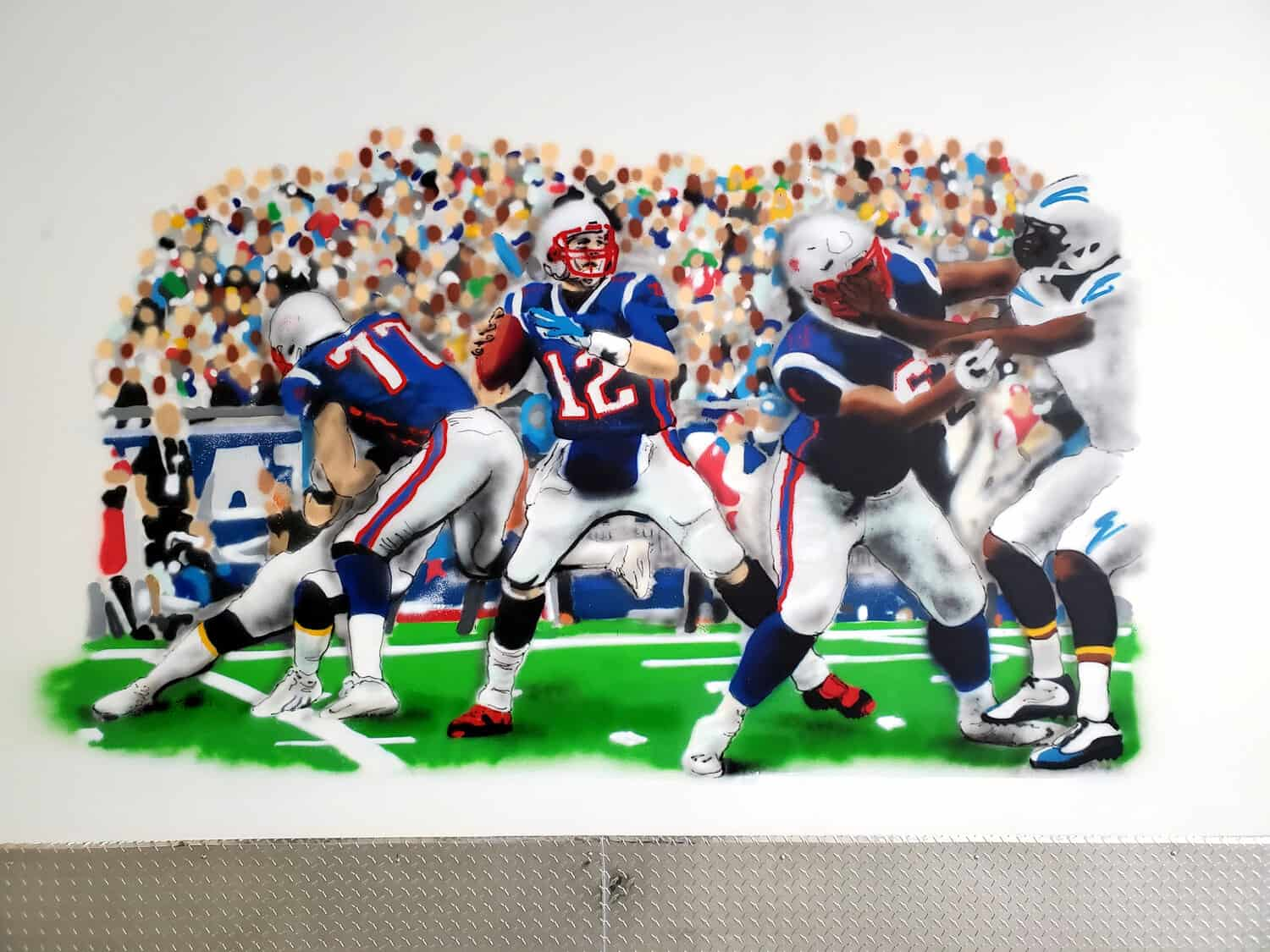 Realistic spray paint mural of the New England Patriots.