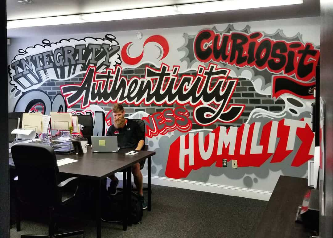 Inspiring graffiti letters in the interior of an office.